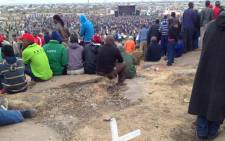 Miners listen to proceedings whilst sitting on the Koppie on the two year anniversary of the Marikana massacre. Picture: Vumani Mkhize/EWN.