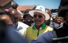 President Jacob Zuma smiles as he is welcomed by a crowd of Philippi residents in Cape Town on 6 January 2015. Picture: Aletta Gardner/EWN.