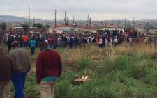 FILE: Police and authorities gather on the piece of land outside Pretoria where hundreds of people descented after they said they have been told by the EFF leaders to build their shacks on 12 November 2014. Picture: Barry Bateman/EWN.