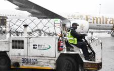 FILE: Vaccines arriving from India are transported from the aircraft to a truck at OR Tambo International Airport on 1 February 2021 before being taken to a secure location for quality assurance checks. Picture: GCIS