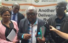 Public Works Minister Thulas Nxesi speaks to the media during a tour of the Diepsloot police station. Picture: Vumani Mkhize/EWN.