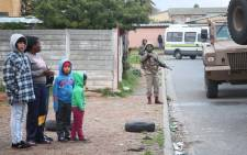 Children standing on the pavement during SANDF operations in Elsies River. Picture: Bertram Malgas/EWN