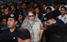 FILE: Bangladesh's main opposition leader and Bangladesh Nationalist Party chairperson Khaleda Zia is escorted to Bangabandhu Sheikh Mujib Medical University (BSMMU) for a medical check-up in Dhaka on 7 April 2018. Picture: AFP