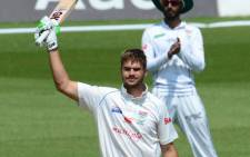 Titans batsman Aiden Markram raises his bat after scoring a 50. Picture: @OfficialCSA/Twitter