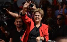 FILE: Brazilian President Dilma Rousseff waves at the crowd during a demonstration to mark International Workers' Day, in Sao Paulo, Brazil, on 1 May, 2016. Picture: AFP.