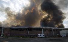 A massive blaze engulfed the Jumbo Cash & Carry near the M1 Highway in Crown Mines on Thursday 25 Feb 2016. Picture: Christa Eybers/EWN