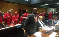 EFF members singing and dancing behind DA Tshwane mayoral elect Solly Msimanga. Picture: Kgothatso Mogale/ EWN.