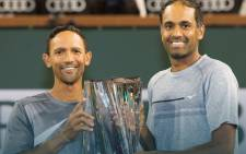 A screengrab of Rajeev Ram and teammate Raven Klaasen, holding the BNP Paribas Open doubles trophy at Indian Wells.