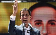 FILE: Venezuelan opposition leader and self-declared acting president Juan Guaido speaks to supporters during a rally in eastern Caracas on 12 February 2019. Picture: AFP
