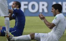 Uruguay forward Luis Suarez reacts after clashing with Italy defender Giorgio Chiellini during a Group D match between Italy and Uruguay at the Dunas Arena in Natal during the 2014 Fifa World Cup on 24 June, 2014. Picture: AFP