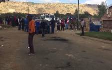 Protesters tried to set a vehicle alight in the Melusi informal settlement during protests on 22 June 2016. Picture: EWN.