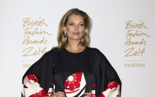 British supermodel Kate Moss poses in the winners room during the British Fashion Awards 2014 in London on 1 December, 2014. Picture: AFP