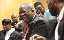 The media scramble to take pictures of Julius Malema and his co-accused during the EFF leader's fraud and corruption trial in Polokwane. Picture: Reinart Toerien/EWN.