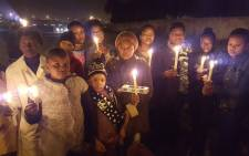 Soweto residents hold a vigil following the rape and murder of Lerato Moloi. Picture: EWN
