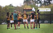 The Blitzbokke discuss tactics during a training session. Picture: Bertram Malgas/EWN