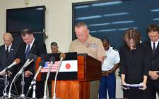 US Marine Corps Lt. Gen. Lawrence D. Nicholson (C), the Okinawa Area Cooordinator and Commanding General of III Marine Expeditionary Force Commander, offers a silent prayer for a murdered Japanese woman during a press conference at Camp Foster in Okinawa on 28 May, 2016. Picture: AFP.