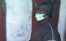 FILE: A 22-year-old Liberian woman saves her family from Ebola by treating them herself and using a trash bag suit for protection. Picture: CNN.