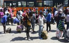 Migrant workers and their family members gather outside Anand Vihar bus terminal as they leave India's capital for their homes during a government-imposed nationwide lockdown as a preventive measure against the COVID-19 coronavirus, in New Delhi on 29 March 2020. Picture: AFP