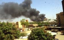 A YouTube screengrab shows black smoke rising from Burkina Faso's military headquarters in Ouagadougou.