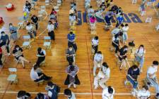 High school students queueing to receive the Sinovac COVID-19 vaccine in Nanjing in China's eastern Jiangsu province on 21 August 2021. Picture: STR/AFP