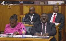 FILE: A screengrab  shows Mbulaheni Maguvhe (front right), Communications Minister Faith Muthambi (front left), and Hlaudi Motsoeneng (back left) in a parliamentary committee meeting.