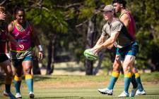 Australia's captain Michael Hooper passes the ball during captain's run at Royal Pines Resort, in Gold Coast on 11 September 2021, ahead of their Rugby Championship match against South Africa. Picture: AFP