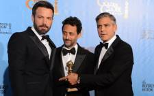 "Actor/director Ben Affleck (L) poses with producers Grant Heslov (C) and George Clooney with the award for best motion picture drama for ""Argo"" at the Golden Globes awards ceremony in Beverly Hills on 13 January 2013. Picture: AFP"