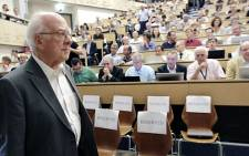 British physicist Peter Higgs arrives for the opening of a seminar to deliver the latest update in the 50-year bid to explain a riddle of fundamental matter in the search for a particle called the Higgs Boson at CERN. Picture: AFP/Pool/Denis Balibouse