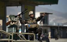 FILE: A member of the Afghan security forces secures the site of a car bomb attack in Kabul on 17 March 2018. Picture: AFP