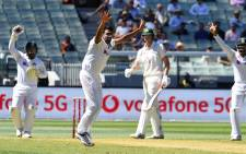 India's Jasprit Bumrah (2nd L) appeals for a decision against Australia's batsman Cameron Green (2nd R) on the first day of the second cricket Test match between Australia and India at the MCG in Melbourne on 26 December 2020. Picture: AFP.