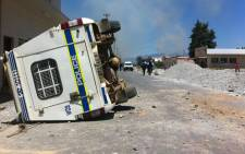A police vehicle lies on its side after protesting farmworkers went on the rampage in Wolseley in the Western Cape on 14 November 2012. Picture: Graeme Raubenheimer/EWN