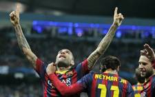 Barcelona defender Dani Alves celebrates his 90th-minute goal against Manchester City in the first legs of their Champions League last 16 ties on 18 February 2014. Picture: Facebook.