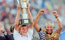 FILE: South African President Nelson Mandela (R) celebrates with Bafana Bafana captain Neil Tovey (L), holding the trophy, on 3 February 1996 after South Africa beat Tunisia 2-0 during the African Cup of Nations final in Johannesburg. Picture: AFP