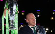 Ireland's captain Paul O'Connell holds the trophy as Ireland players celebrate at a presentation after the Six Nations international rugby union match between Scotland and Ireland at Murrayfield in Edinburgh, Scotland on 21 March, 2015. Picture: AFP.