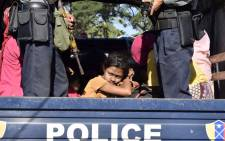 FILE: Myanmar police escort Rohingya Muslims back to their camp in Sittwe, Rakhine state, on 30 November 2018. Nearly 100 Rohingya Muslims were forced back to Myanmar's Rakhine state after being detained at sea en route to Malaysia, police said on 28 November, stirring fears of a fresh refugee boat crisis. Picture: AFP