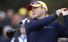 FILE: A file photo taken on 14 November 2013, shows Australian golfer Jarrod Lyle teeing off during the first round of the Australian Masters golf tournament played at the Royal Melbourne course in Melbourne. Picture: AFP