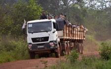A truck carrying Muslims who fled Bangui is escorted by the French Sangaris Operation troops (not seen) in Grimari in the Central African Republic on 20 April, 2014. Picture: AFP.