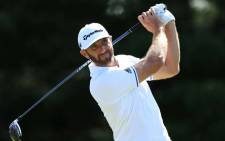 FILE: Dustin Johnson of the United States plays his shot from the 18th tee during the third round of the Sentry Tournament of Champions at Plantation Course at Kapalua Golf Club on January 6, 2018 in Lahaina, Hawaii. Picture: AFP.