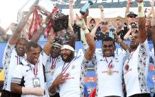 Fiji players celebrate after winning the Cup Final match 35-19 over New Zealand during the USA Sevens Rugby tournament at Sam Boyd Stadium on 15 February, 2015 in Las Vegas, Nevada. Picture: AFP.