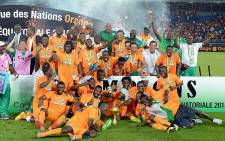 Ivory Coast celebrate after beating Ghana to become the 2015 African Cup of Nations champions. Picture: AFP.
