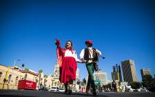 Little Red Riding Hood and The Huntsman educate pedestrians about traffic safety in Cape Town's CBD. Picture: Thomas Holder/EWN
