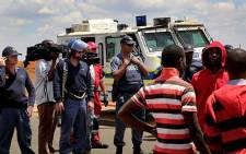 FILE: Residents of Bekkersdal in Westonaria in a stand-off with police during a service delivery protest in 2013. Picture: EWN