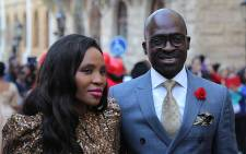 FILE: Malusi Gigaba added a bit of flair to his suit with a red flower, while his partner wore a figure-hugging gold sequined dress. Picture: GCIS.