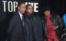Chris Rock and Kanye West and Jadakiss attend the 'Top Five' New York Premiere at Ziegfeld Theater on 3 December, 2014 in New York City. Picture: AFP.