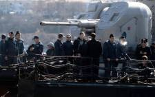 Ukrainian soldiers stand guard on board the navy corvette Ternopil as Russian forces patrol nearby in the harbour of the Ukrainian city of Sevastopol on March 5 2014. Picture: AFP.