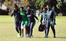 Banyana Banyana striker Chantelle Esau is helped off the field by medical staff. Picture: @Banyana_Banyana/Twitter
