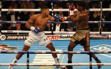 FILE: British boxer Anthony Joshua and US boxer Charles Martin during their IBF World Heavyweight title boxing match at the O2 arena in London on 9 April 2016. Picture: AFP