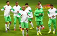 FILE: Algeria's footballers jog during a training session on 29 June, 2014 at Arena do Gremio in Porto Alegre, on the eve of their Brazil 2014 Fifa World Cup Round of 16 football match against Germany. Picture: AFP.