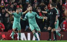 Arsenal players react to a penalty given against them during the English Premier League match against Liverpool at Anfield on 29 December 2018. Picture: AFP