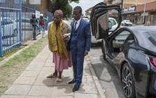 Pastor Paseka 'Mboro' Motsoeneng arrives at the Alberton Police Station with the mother of the child who had died at his church in Katlehong on 24 December, 2017. Picture: Ihsaan Haffejee/EWN